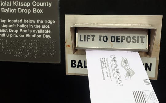 FILE — A ballot is deposited into the drop box at the Kitsap County Administration Building.