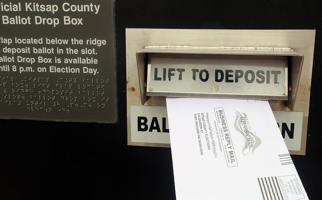 A ballot is deposited into the drop box at the Kitsap County Administration Building on Tuesday, November 5, 2019.