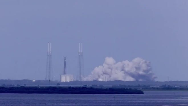A SpaceX Falcon 9 rocket test fires its nine Merlin engines at Cape Canaveral Air Force Station's Launch Complex 40 on Tuesday, Nov. 5, 2019.