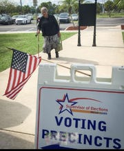 "Billie Mitchell, 75, arrives at Palm Bay City Hall complex to vote Tuesday. ""If these young people see me with a cane, they might think 'If she can do it, I will,' and they will all get out and vote,"" she said."