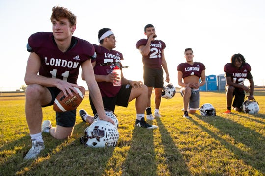 London quarterback Ty Leonard and other offense players wait as the defense runs drills on during practice on Monday, Nov. 5, 2019.