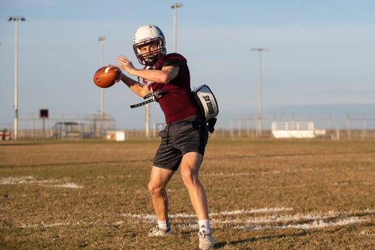 London quarterback Ty Leonard warms up during practice on Monday, Nov. 5, 2019.