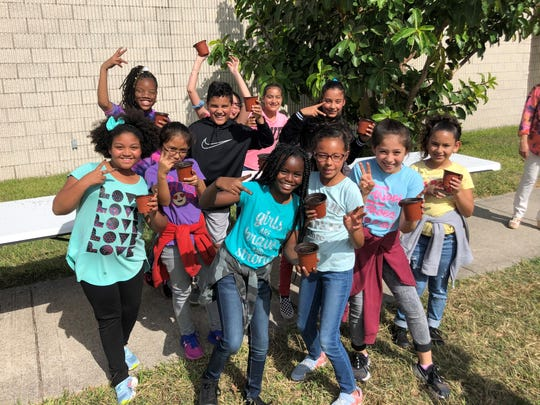 Students pose with their newly potted acorns at Dr. M.L. Garza-Gonzalez Charter School on Tuesday, Nov. 5, 2019. The school is participating in Reforest Texas, a program that promotes reforesting as a solution to climate change.