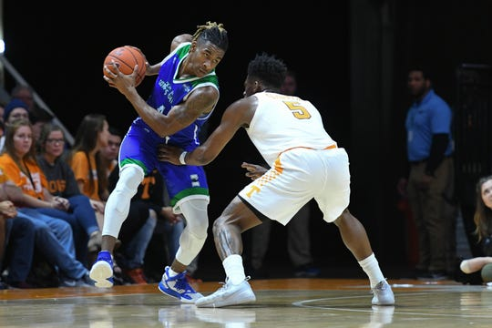Texas A&M-Corpus Christi Islanders guard Jashawn Talton (4) is defended by Tennessee Volunteers guard Admiral Schofield (5) during the first half at Thompson-Boling Arena.