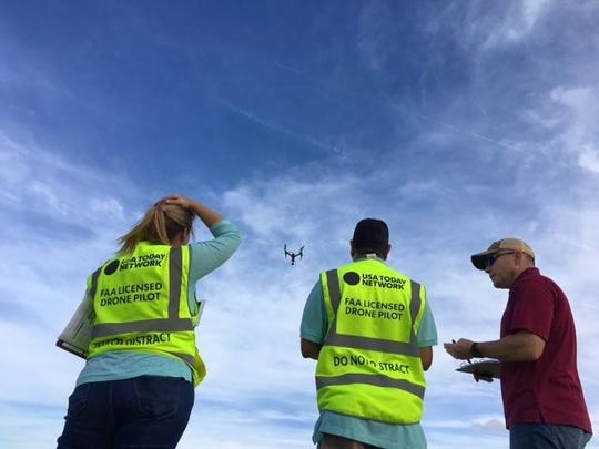 Chris Ramirez (center) practices piloting a drone as part of the Caller-Times drone team. The longtime journalist also reports and edits for the news organization, which is part of The USA TODAY Network.