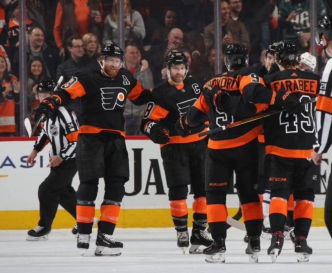 The Flyers celebrate a power-play goal by Ivan Provorov Saturday night.