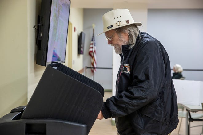 Jim Kuker casts his vote at The Kenton County Library in Covington on Tuesday, November 5, 2019. Kuker said he has voted in Kentucky for almost 20 years after moving from Ft. Wayne, Indiana.