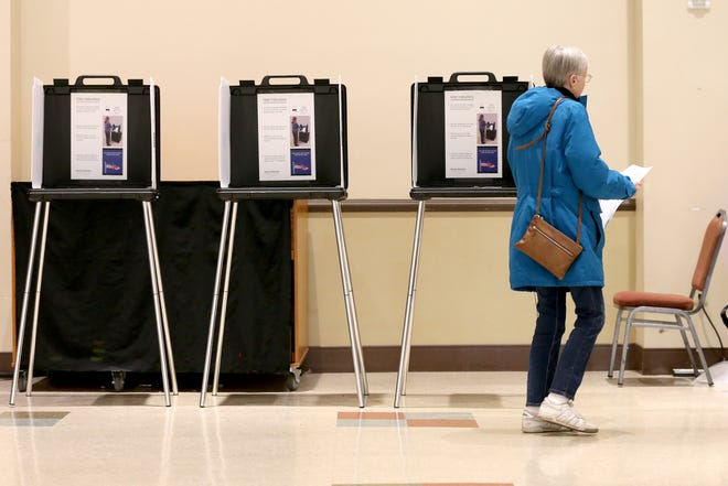 A voter casts her ballot, Tuesday, Nov. 5, 2019, at Knox Presbyterian Church in Hyde Park.