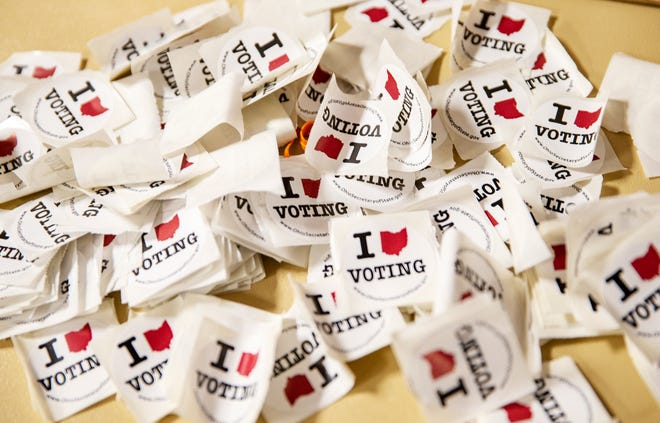 A pile of stickers for voters to pick up after voting at The Grove Banquet Center in Springfield Township on Tuesday, Nov. 5, 2019.