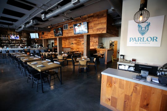 View of the host stand and dining room, Friday, Nov. 1, 2019, at Parlor on Seventh restaurant in Covington, Ky.