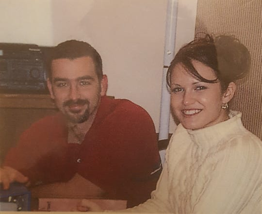 Wes Feltner with JoAnna Hendrickson at her parents' house in Christmas 2002.
