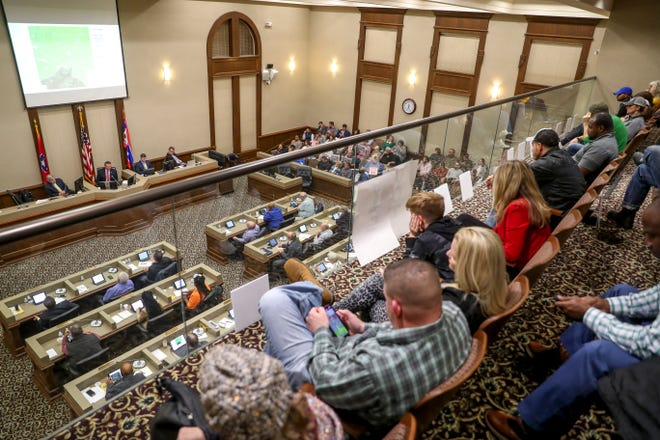 Residents fill every public seating spot on the floor and most seats in the balcony during a county commission meeting last year.