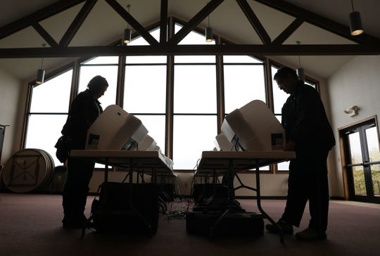 Voters cast their ballots at Emmanuel Lutheran Church in Coshocton on Tuesday. Four precincts vote at the church.