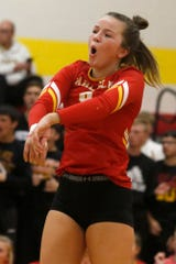 Carlisle senior Molly Hoekstra reacts to a Wildcat point. Carlisle lost in three games at Marion in a Class 4A regional final on Nov. 4.