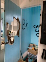 Unidentified vandals spray-painted graffiti onto several walls and damaged the Monsoon community center on Des Moines' east side the first weekend of November 2019.