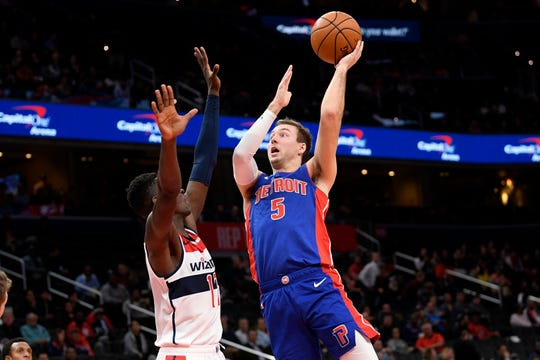 Luke Kennard goes to the basket against Wizards forward Isaac Bonga during the first half Monday in Washington.