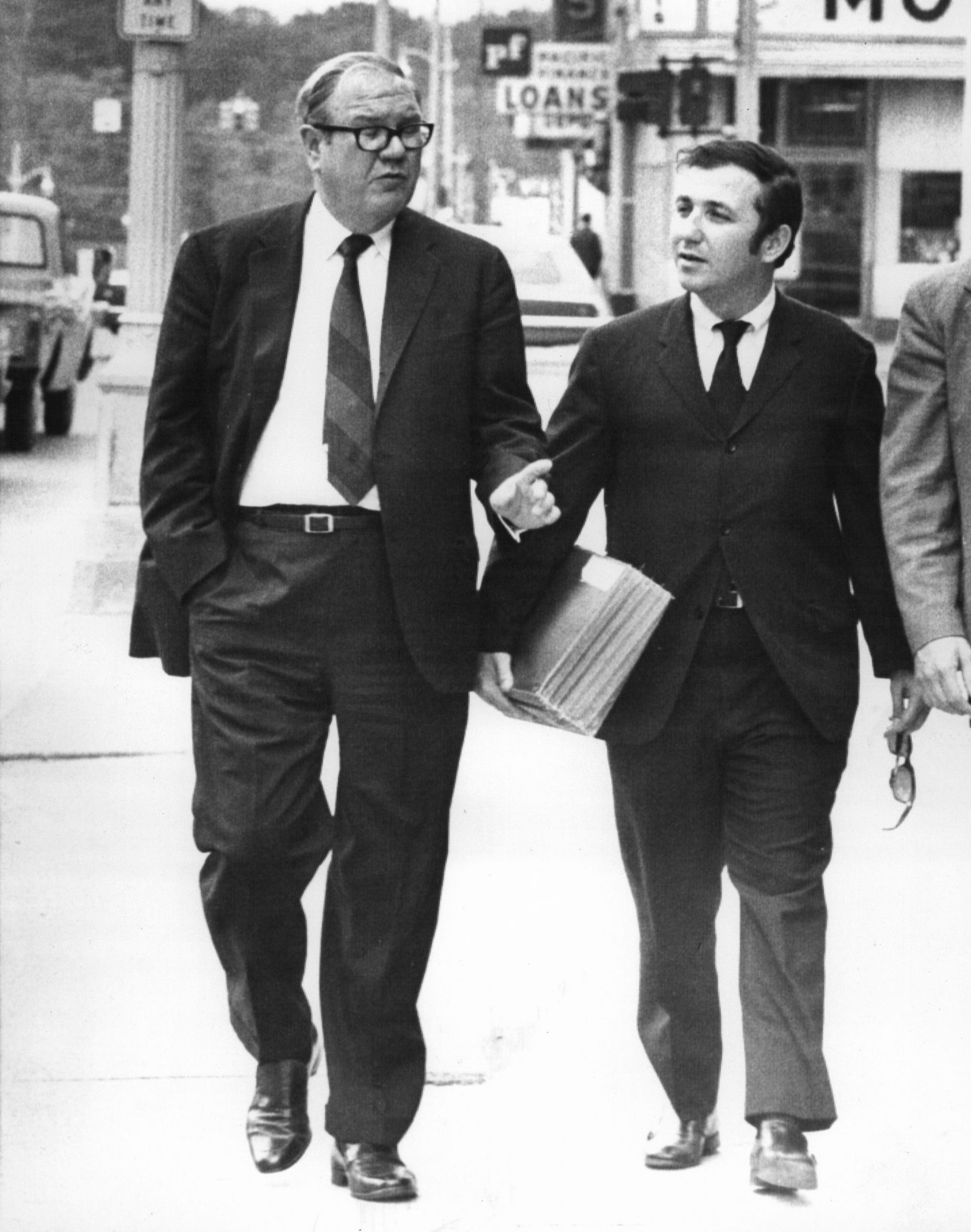 Joseph W. Louisell, left, chief defense attorney and his assistant Neil H. Fink leave court June 2, 1970 at the end of the first day in the murder trial of John Norman Collins, 22, in Ann Arbor, Mich.