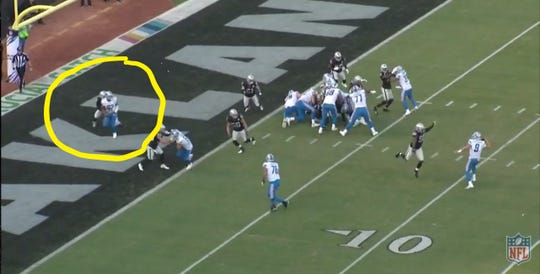 Matthew Stafford looks to pass to tight end Logan Thomas in the end zone.