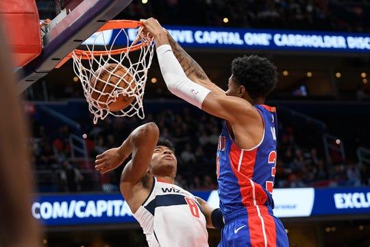 Detroit Pistons forward Christian Wood dunks over Washington Wizards forward Rui Hachimura during the first half Monday, Nov. 4, 2019, in Washington.