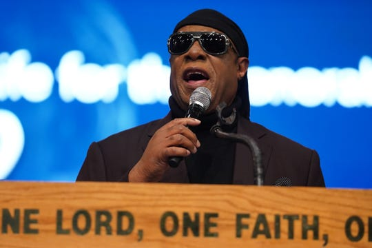 Stevie Wonder speaks to the crowd during the funeral for the late Congressman John Conyers Jr. on Monday, November 4, 2019 at Greater Grace Temple in Detroit.