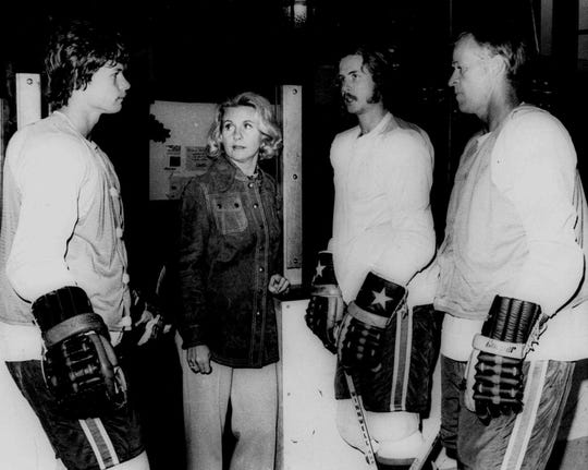 Marty Howe, left, Colleen Howe, Mark Howe and Gordie Howe have a family discussion during a break after practice in Houston, Texas in 1974.