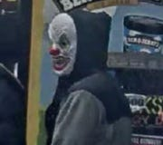 A man in a clown mask allegedly shot and killed another man at a gas station on Halloween night.
