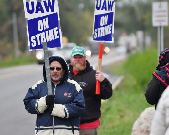 UAW members strike at the GM Romulus Powertrain plant in this October 16, 2019, file photo. Local information is more volatile than national data to voters, and single events can greatly affect the state economies. Recent trade uncertainties and the General Motors strike likely contributed to the expected weakness in the Rust Belt states that could affect President Trump's re-election chances.