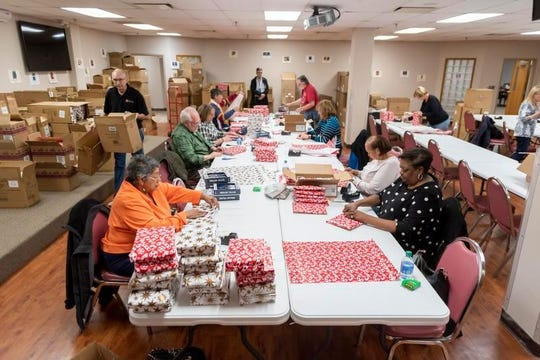 Volunteers with the Salvation Army are busy collecting and wrapping presents to deliver this Christmas to Michigan children whose mothers and fathers are incarcerated.