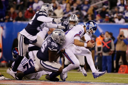 New York Giants quarterback Daniel Jones (8) is sacked by the Dallas Cowboys during the fourth quarter.