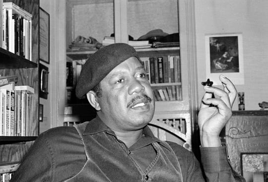 "This April 12, 1977 file photo shows author Ernest Gaines who wrote ""The Autobiography of Miss Jane Pittman,"" in his San Francisco home. Gaines, whose poor childhood on a small Louisiana plantation town germinated the stories of black struggles that grew into universal stories of grace and beauty, has died. He was 86. The Louisiana governor's office released word of his death on Tuesday, Nov. 5, 2019. (AP Photo, File)"