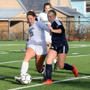 Pleasantville's Analese PIcart (22) and Aubrey Bough of Chenango Forks battle or possession during a Class B girls soccer regional semifinal Nov. 5, 2019 at Waverly Memorial Stadium.