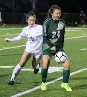 Dayna Hovancik (24) of Vestal tries to control the ball as Mary Windram (5) of Pearl River closes in during a Class A girls soccer regional semifinal Nov. 5, 2019 at Waverly Memorial Stadium.
