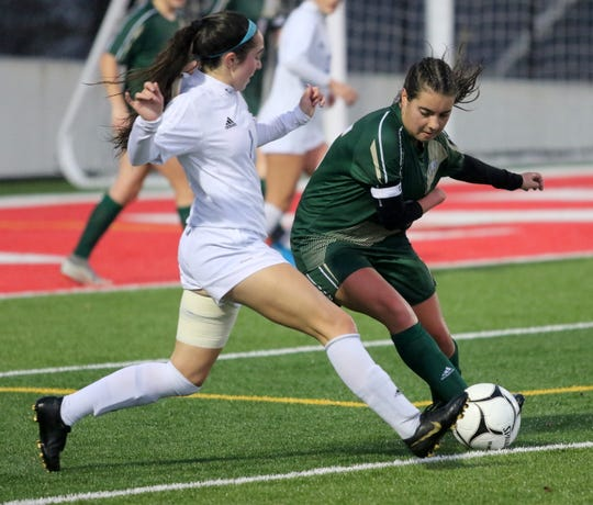 Vestal's Alexia Michitti controls the ball as Pearl River's Matteson Donnelly defends during a Class A girls soccer regional semifinal Nov. 5, 2019 at Waverly Memorial Stadium.
