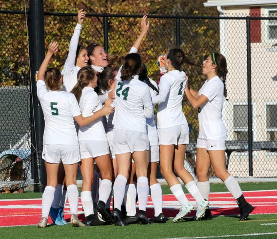 Pleasantville players celebrate their 2-0 win over Chenango Forks in a Class B girls soccer regional semifinal Nov. 5, 2019 at Waverly Memorial Stadium.