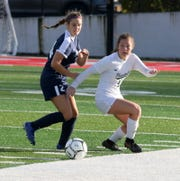 Pleasantville's Grace Capko (11) kicks the ball ahead as Taylor Maus of Chenango Forks defends during a Class B girls soccer regional semifinal Nov. 5, 2019 at Waverly Memorial Stadium.