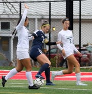 Emma Bough of Chenango Forks controls the ball in between Pleasantville's Carolyn Lee, left, and Julia O'Reilly during a Class B girls soccer regional semifinal Nov. 5, 2019 at Waverly Memorial Stadium.