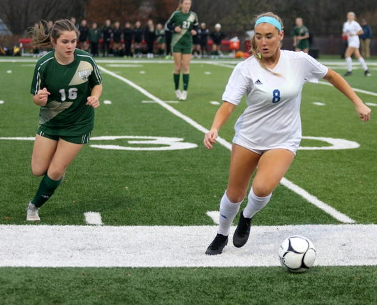 Sydney Sprague (16) of Vestal defends Kylie McNally (8) of Pearl River during a Class A girls soccer regional semifinal Nov. 5, 2019 at Waverly Memorial Stadium.