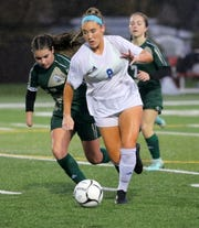 Kylie McNally of Pearl River kicks the ball ahead as Vestal's Alexia Michitti gives chase during a Class A girls soccer regional semifinal Nov. 5, 2019 at Waverly Memorial Stadium.