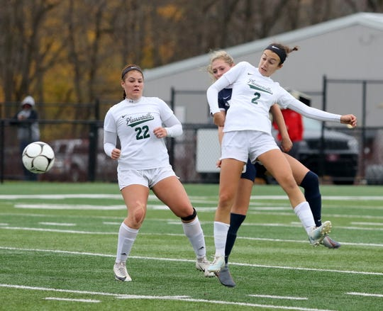 Julia O'Reilly (2) of Pleasantville kicks the ball forward as teammate Analese Picart (22) and Lauren Ashman of Chenango Forks look on during a Class B girls soccer regional semifinal Nov. 5, 2019 at Waverly Memorial Stadium.