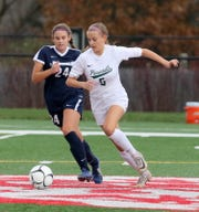 Allison Portera (5) of Pleasantville and Taylor Maus (24) of Chenango Forks battle for possession during a Class B girls soccer regional semifinal Nov. 5, 2019 at Waverly Memorial Stadium.