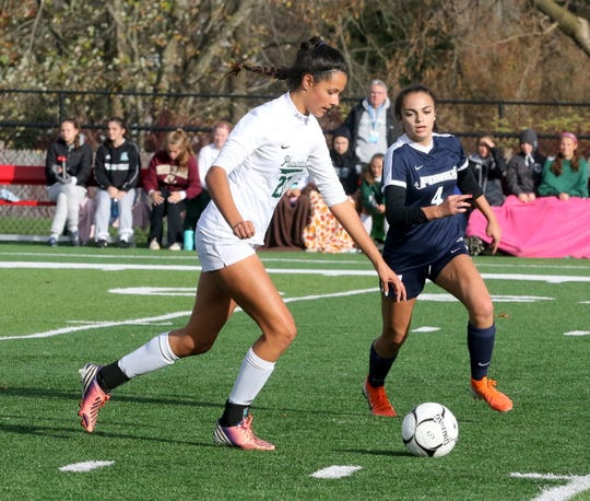 Isabelle Kapoor of Pleasantville controls the ball as Gabby Markham (4) of Chenango Forks closes in during a Class B girls soccer regional semifinal Nov. 5, 2019 at Waverly Memorial Stadium.