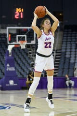 University of Evansville's Jossie Hudson (22) looks to make a pass during the education day game against the Brescia Bearcats at Ford Center in Evansville, Tuesday, Nov. 5, 2019. The Lady Purple Aces defeated the Bearcats, 77-61.