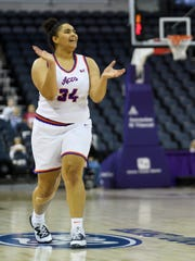 University of Evansville's Alexis Thomas (34) reacts to her team netting more points against the Brescia Bearcats during an education day game at Ford Center in Evansville, Ind., Tuesday, Nov. 5, 2019. The Lady Purple Aces defeated the Bearcats, 77-61.