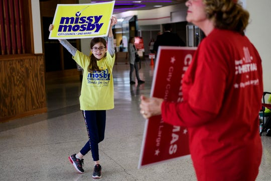 Eleven-year-old Laura Diekmann, left, asks people passing by her to vote for 2nd Ward City councilwoman Missy Mosby as Kathy Molloy, right, does the same for David Christmas, a City Council at Large candidate, inside Washington Square Mall in Evansville, Tuesday morning, Nov. 5, 2019.