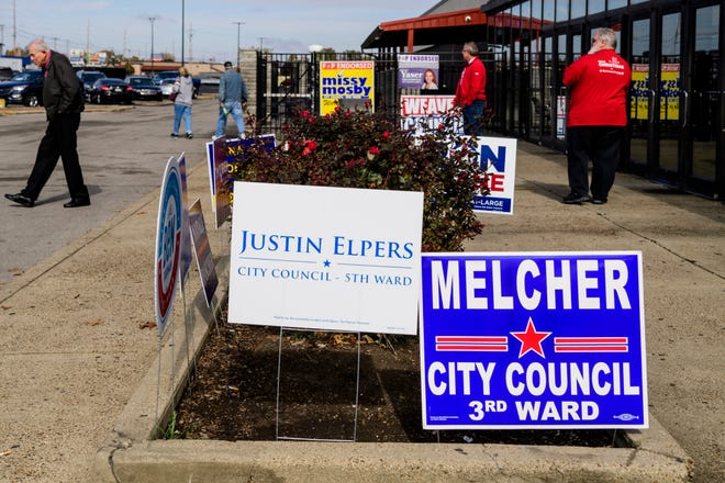 Political campaign signs surround the garden beds in front of Washington Square Mall, one of 16 polling places that Evansville residents could cast their votes, Tuesday morning, Nov. 5, 2019.
