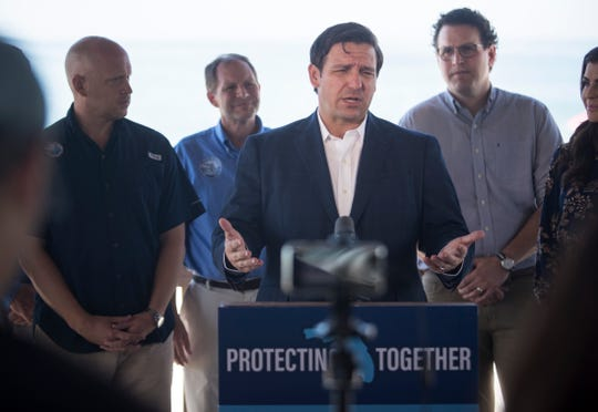 Governor Ron DeSantis speaks about the state's new website for water quality, protectingfloridatogether.gov, during a press conference at Lovers Key State Park on Tuesday, Nov. 5, 2019.