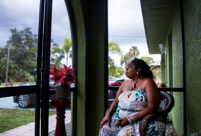 Antonette Gilmore Anderson sits on her lanai in front of her Lemon Street home in Fort Myers on Monday, Nov. 4, 2019. She is concerned about the encroachment of commercial uses to her neighborhood due to rezoning changes by the City of Fort Myers. The rezoning changes are expected to be voted on by city council members.