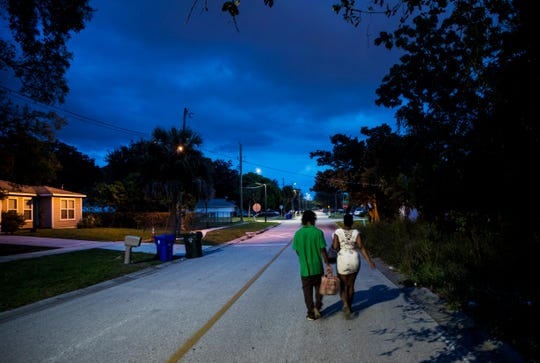 People walk on Lemon Street in Fort Myers on Tuesday, Nov. 5, 2019. Some residents are concerned about the encroachment of commercial uses to the neighborhood due to rezoning changes by the City of Fort Myers. The rezoning changes are expected to be voted on by city council members.