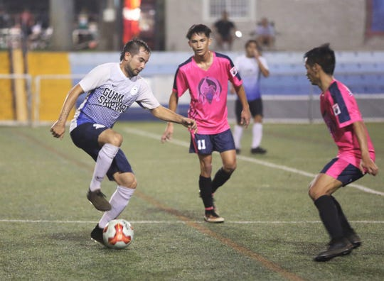 Guam Shipyard's Donald Weakley controls the ball as Lots of Art Tattoo Heat's Seth Surber (middle) and Fred Alig III (right) track him defensively in a Week 3 Premier Division match of the Budweiser Soccer League Saturday at the Guam Football Association National Training Center. LOA Heat won 4-1.