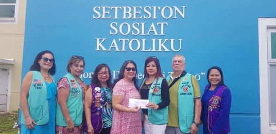 Guam Galaide Lions Club donated $1,000 for various Saipan typhoon recovery and relief efforts to Saipan Karidat Director Lauri Ogumoro,. Receiving the donation  on their behalf, is Catholic Social Services Director Diana Calvo on Oct. 22. Present from left: Lion Blanca Imbo, Galaide Club's global service team chair and D204 Zone 3 Chairperson, Lion Zeny Cachila, Guam Galaide Club Secretary, District Governor Fely Angel, Calvo, L. President and Chairperson for this project Belle Mendiola, Lion Tom Farrior, Peace and Safety Officer, and District Cabinet Secretary Lion Michelle Taitano.